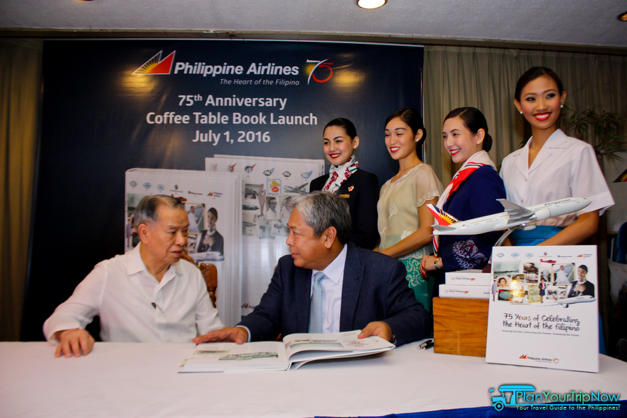 PAL Chairman/CEO Dr. Lucio Tan and PAL President/COO Jaime Bautista. Background: Flight Attendants wearing the different uniforms through the years.